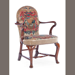 A George I walnut shepherd's crook armchair