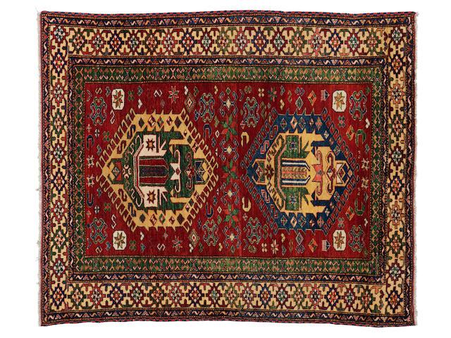 """A Caucasian rug 185cm x 150cm (6'1"""" x 4'11"""")."""