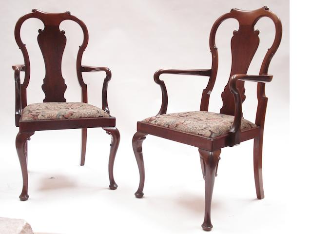 A pair of 20th century mahogany armchairs