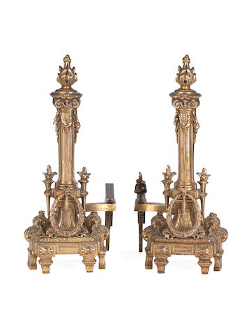 A pair of cast brass fire dogs