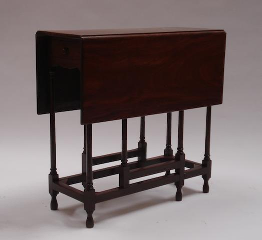 An 18th century and later mahogany spider-leg gate-leg Pembroke table
