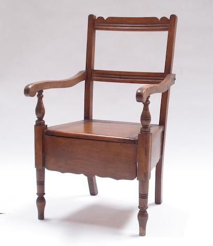 A 19th century Ayrshire stained beech commode armchair