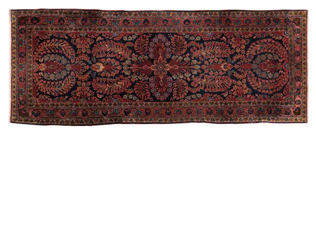 """An Isfahan rug 195cm x 85cm (6'5"""" x 2'10"""")."""