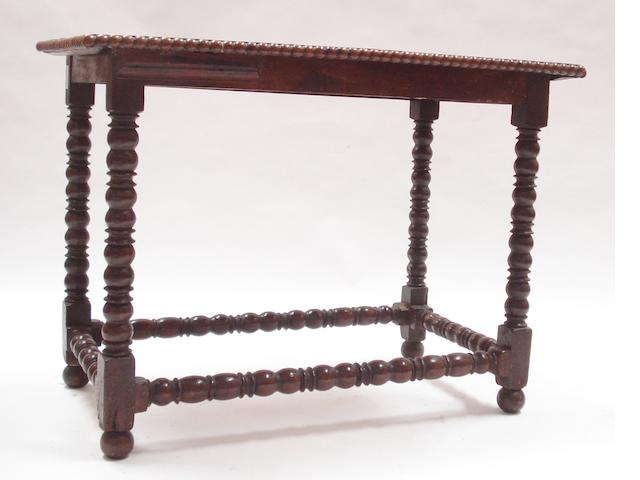 A 17th century and later oak centre table