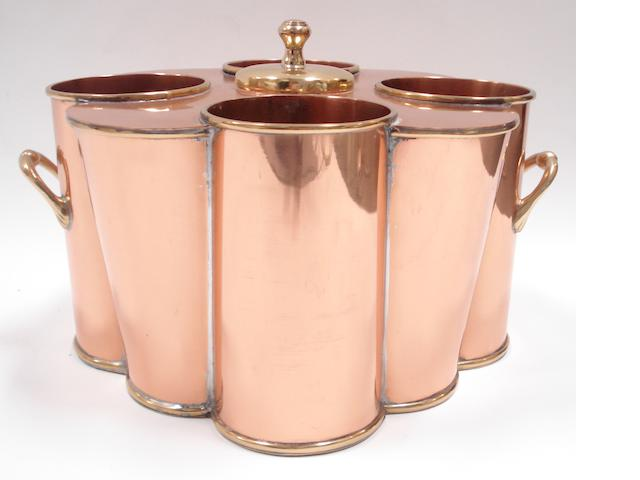 A copper and brass two-handled wine cooler