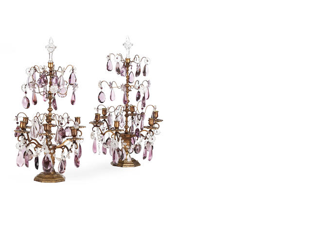 A pair of gilt metal clear and amethyst glass table girandoles