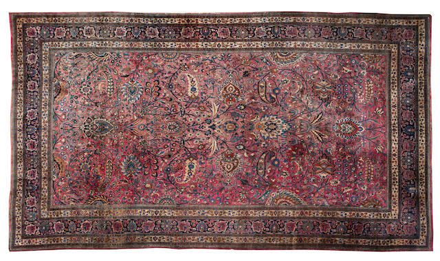 "A Meshed carpet 750cm x 425cm (24'8"" x 13'11"")."