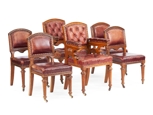 A set of six Victorian carved oak dining chairs