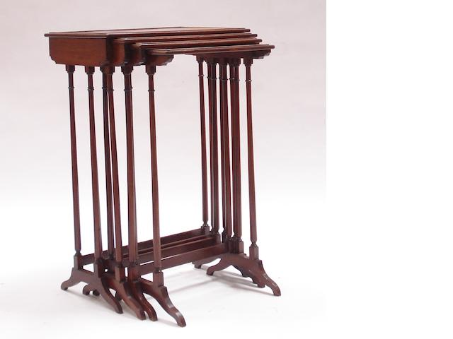 A set of Regency style mahogany quartetto tables
