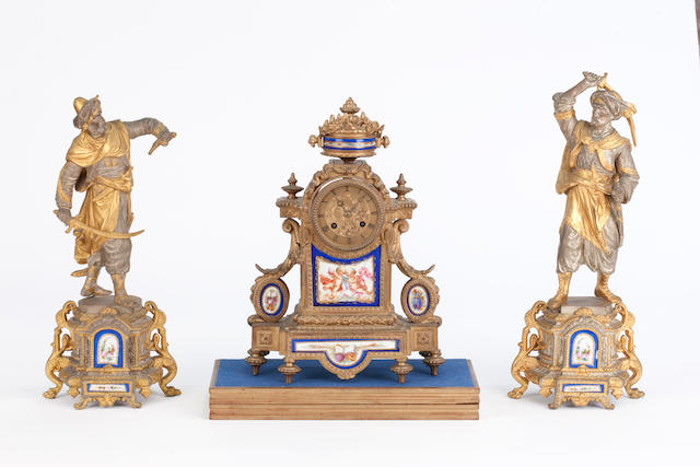 A late 19th century gilt and silvered metal clock garniture