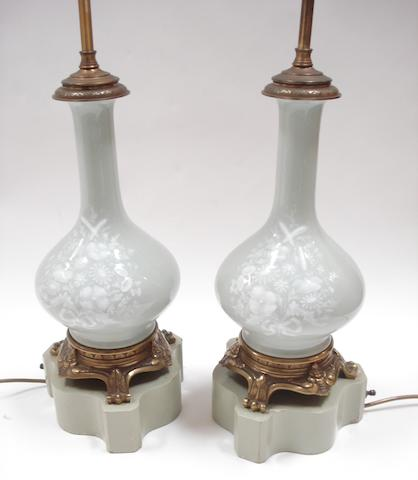 A pair of 20th century brass mounted pate-sur-pate celadon ground  table lamps