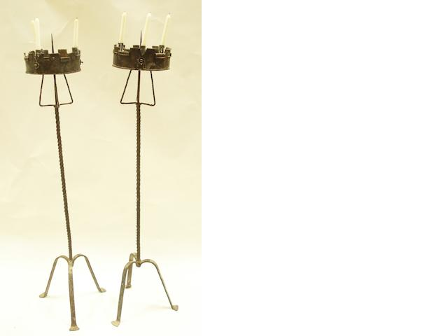 A pair of wrought iron standard candelabra