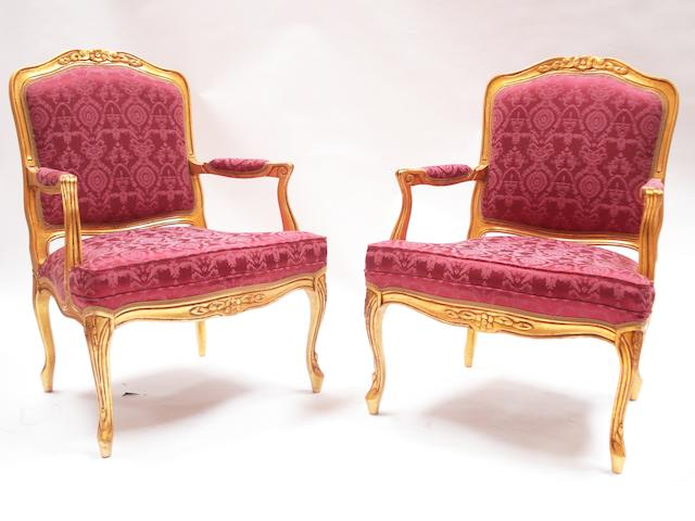 A pair of 20th century later gold painted fauteuils