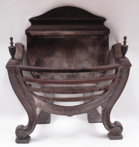 A Neoclassical style cast iron fire basket
