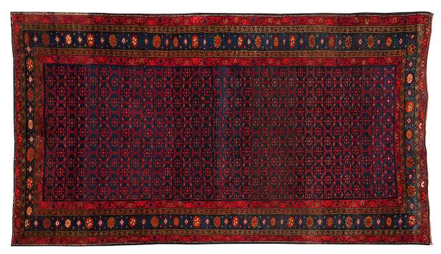 "A Kurdistan rug 227cm x 130cm (7'5"" x 4'3"")."