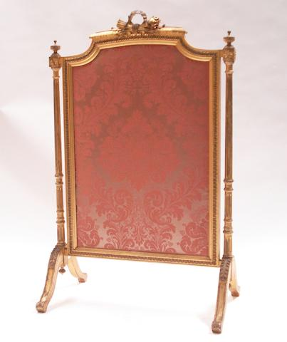A Regence style carved giltwood fire screen