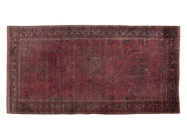 "A large Sarouk carpet 705cm x 307cm (23'2"" x 10'1"")."