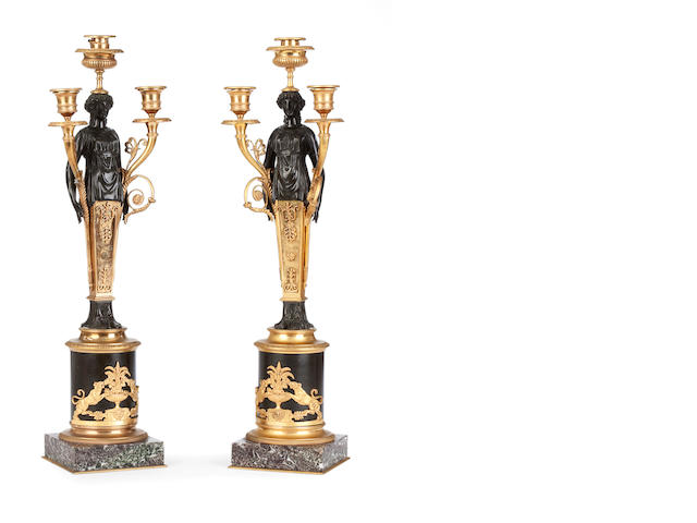 A pair of Regency style bronze and gilt bronze three branch candelabraAfter a design by Thomas Hope
