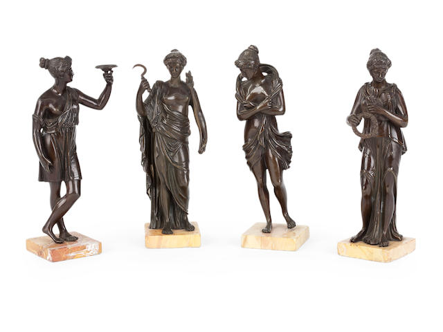 A set of four Italian 19th century bronze figures