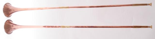 A pair of copper and brass coaching horns