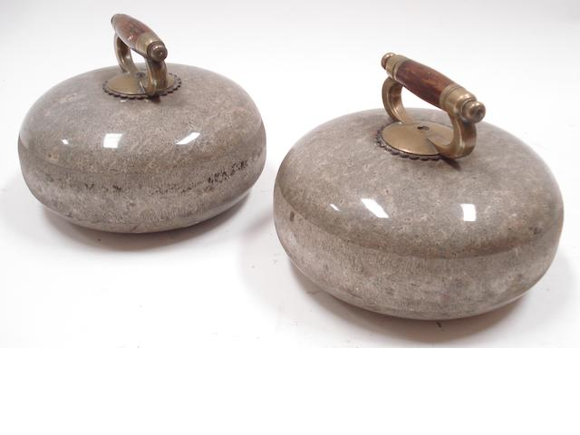 A pair of grey granite curling stones