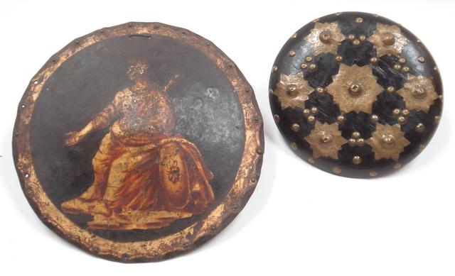 A painted circular cast iron shield