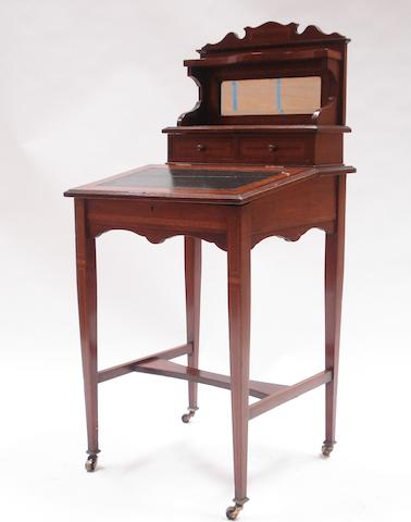 An Edwardian mahogany, satinwood cross-banded and line inlaid writing desk