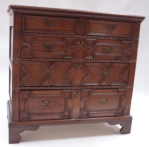 A 17th century style carved oak chest