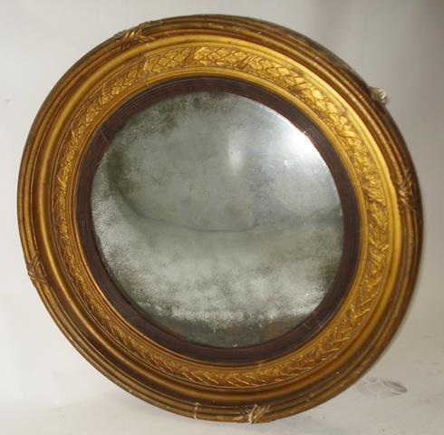 A Regency giltwood and gesso convex wall mirror