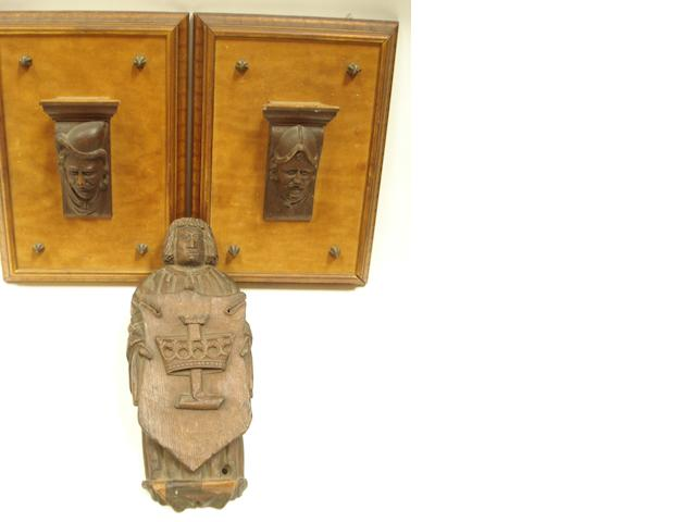 A carved oak figure of a herald,