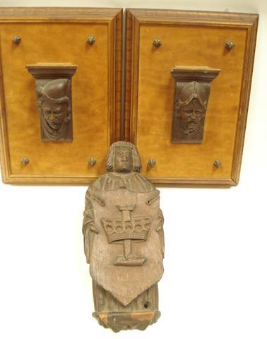 A carved oak figure of a herald,