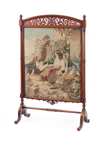 A Victorian walnut firescreen