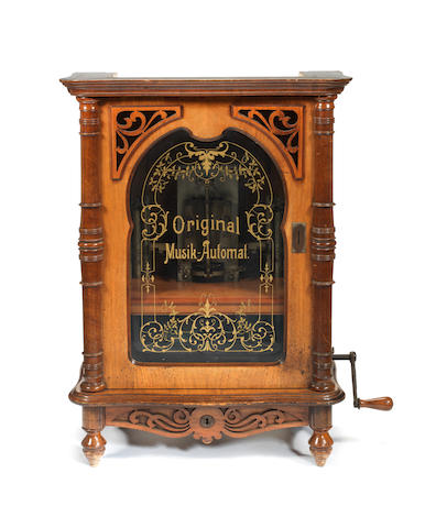 A rare 16.7/8-inch Lochmann's 'Original Musik-Automat', coin-operated upright disc musical box,