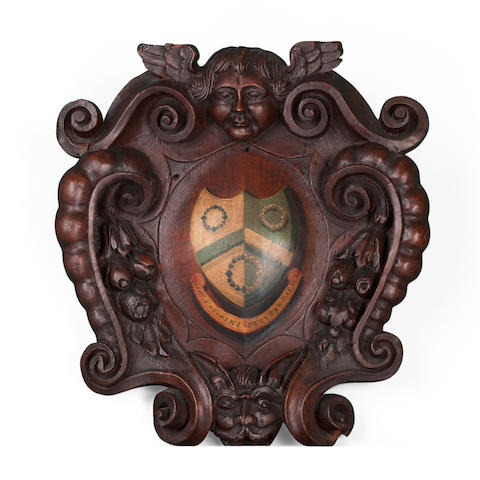 An early 18th century carved oak and painted cartouche depicting the Yarburgh coat of arms