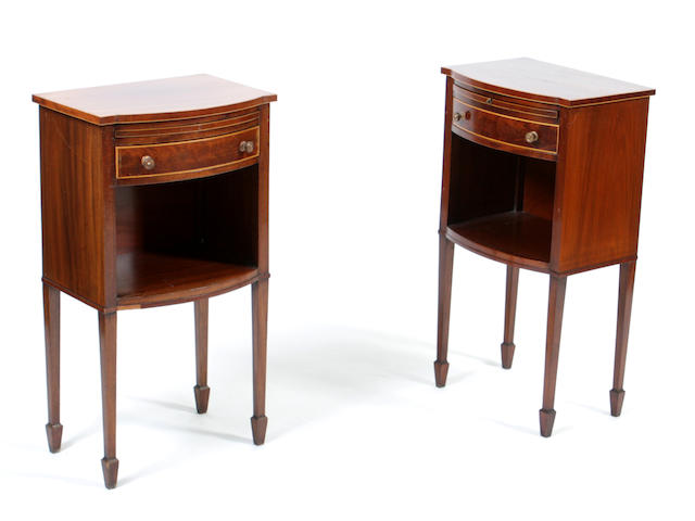 A pair of Edwardian bowfront mahogany tables