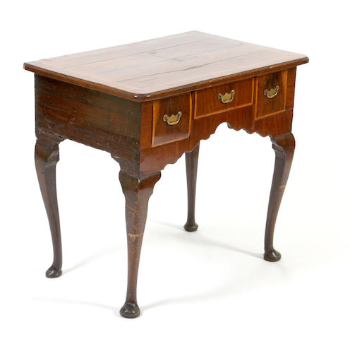 An early 18th century and later walnut lowboy
