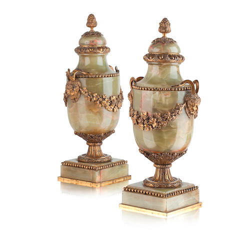 A pair of late 19th century neo-classical green agate urns