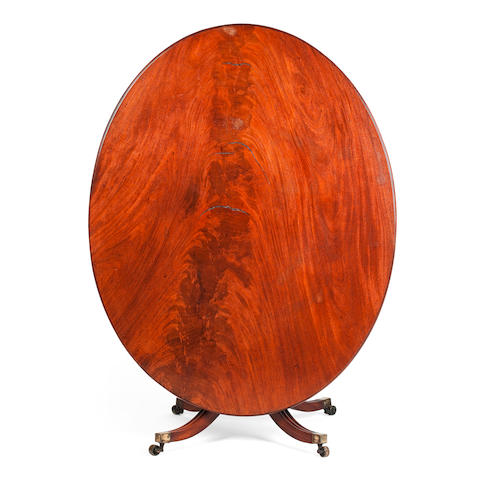 A late George III mahogany oval centre table