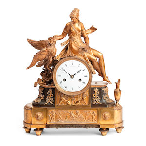 A Restauration bronze and gilt-bronze mantel clock