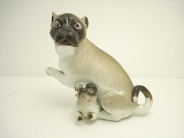 An English Meissen style group of a pug and its pup Early 19th century