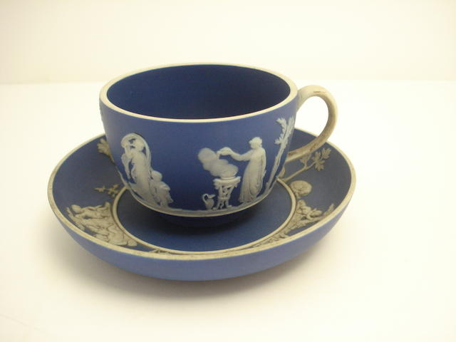 A Wedgwood blue jasperware tea cup and saucer