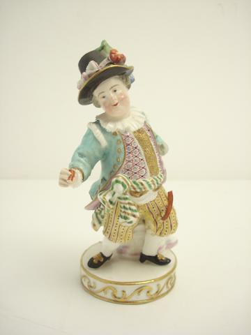 A Meissen figure of a dwarf entertainer 19th century