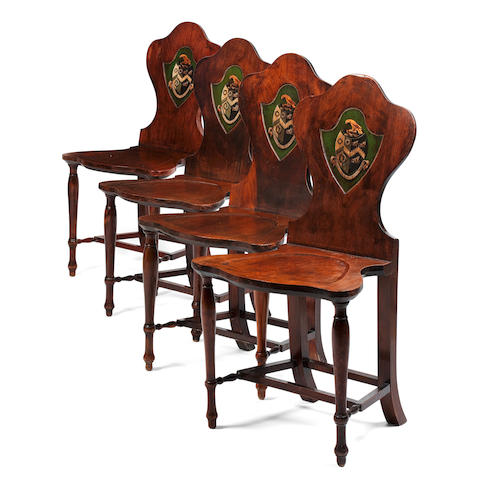 Seven George II fruitwood hall chairs