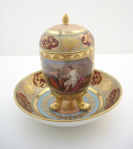 A Vienna style chocolate cup, cover, and saucer Circa 1900