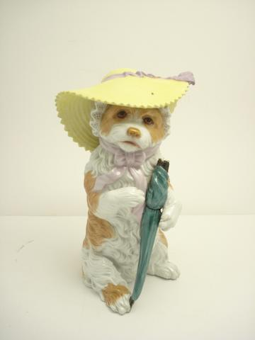 A Vienna figure of a lap dog in amusing pose Early 20th century