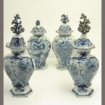 Four Dutch delft blue and white vases and covers 18th century