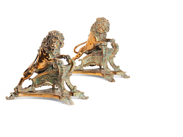 A pair of French late 19th century cast brass andirons