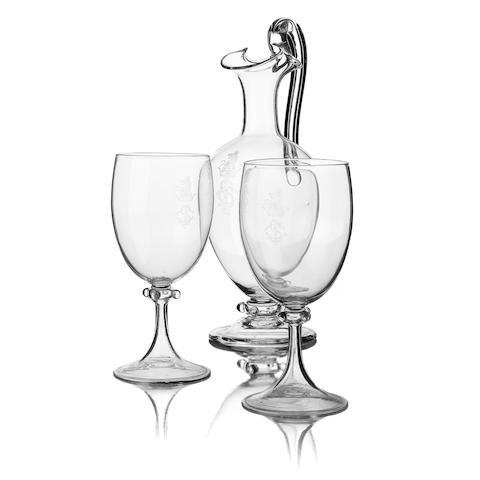 A claret jug and two matching goblets  Circa 1900