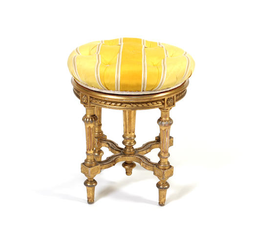 A late 19th century giltwood and gesso revolving piano stool