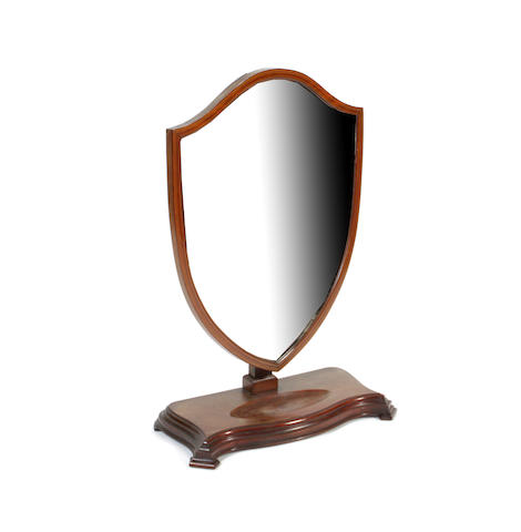 An Edwardian mahogany shield shaped dressing mirror